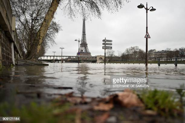 TOPSHOT A photo taken on January 23 2018 shows flooded banks of the river Seine which level has risen in front of the Eiffel tower in Paris / AFP...
