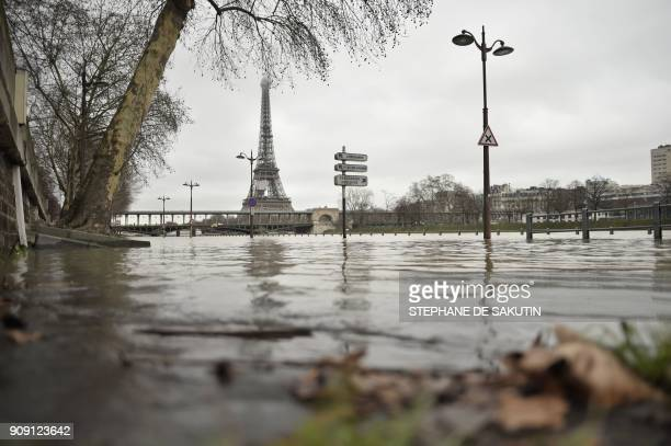 A photo taken on January 23 2018 shows flooded banks of the river Seine which level has risen in front of the Eiffel tower in Paris / AFP PHOTO /...