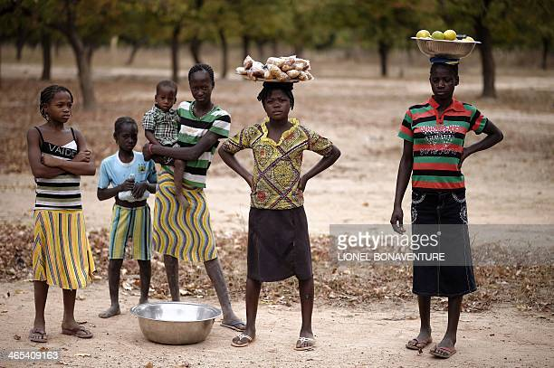 A photo taken on January 24 2014 shows peanuts and fruits street sellers in Leo Burkina Faso The French cosmetics company L'Occitane has been working...