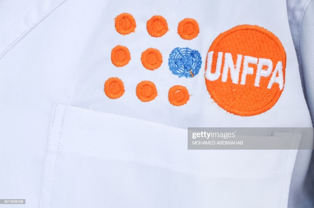 A photo taken on January 24, 2018 shows an embroidery of logo of the United Nations Population Fund (UNFPA), which supports the Puntland Forensic Center, on a lab tecnician's white coat during demonstrations of DNA testing at the Puntland Forensic Center in Garowe, Puntland State, Somalia. The first Forensic Center in Somalia, partly funded by the Swedish government and supported by the United Nations Population Fund (UNFPA), brings advanced DNA testing capabilities to a country still lacking in paved roads and reliable electricity. The hope is that the DNA sample will help convict the woman's rapist, ushering in a new era of justice for the victims of Somalia's widespread sexual violence. / AFP PHOTO / Mohamed ABDIWAHAB