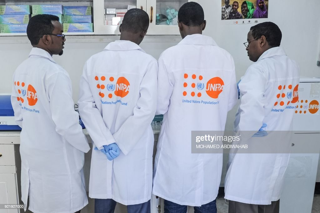 A photo taken on January 24, 2018, shows the laboratory technicians demonstrating DNA testing at the Puntland Forensic Center in Garowe, Puntland State, Somalia. The first Forensic Center in Somalia, partly funded by the Swedish government and supported by the United Nations Population Fund (UNFPA), brings advanced DNA testing capabilities to a country still lacking in paved roads and reliable electricity. The hope is that the DNA sample will help convict the woman's rapist, ushering in a new era of justice for the victims of Somalia's widespread sexual violence. / AFP PHOTO / Mohamed ABDIWAHAB