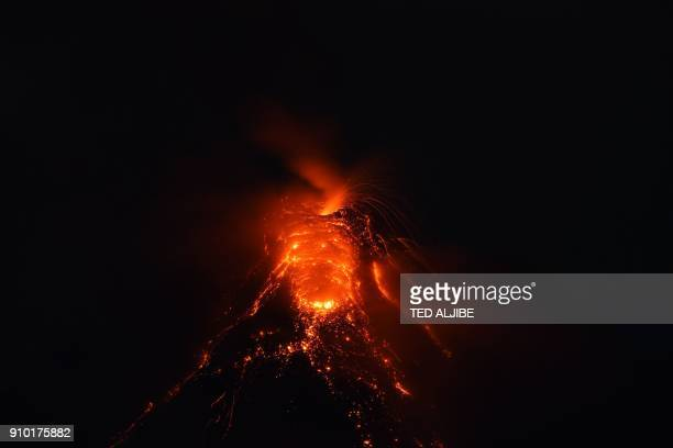 A photo taken on January 25 2018 from the city of Legazpi Albay province south of Manila shows a fiery fountaining during an eruption of the Mayon...