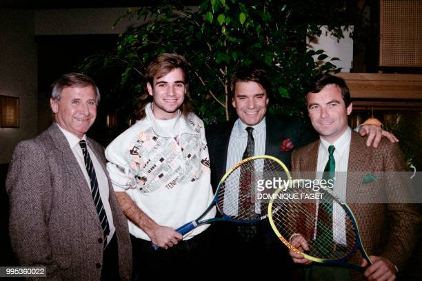 Photo taken on January 26 1989 shows French team coach Michel Hidalgo US tennis player André Agassi French president of the Olympique de Marseille...