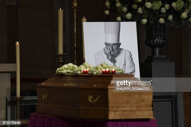 A photo taken on January 26 2018 shows the coffin of French chef Paul Bocuse during the funeral ceremony t the SaintJean Cathedral in Lyon More than...