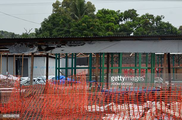 Photo taken on January 27 2015 shows tents being dismantled after Doctors Without Borders decommissioned the first section of the ELWA III Ebola...