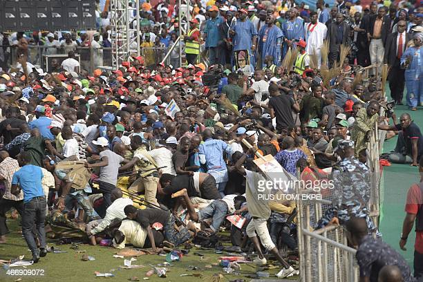 A photo taken on January 30 2015 shows party supporters falling and running for safety as thugs fight during a rally by main oppopsition All...
