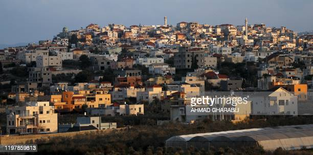 A photo taken on January 30 shows a view of the ArabIsraeli town of Baqa alGharbiya in northern Israel In northern Israel residents of the Arab...