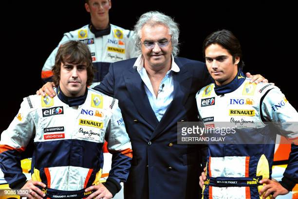 Photo taken on January 31, 2008 of Renault drivers Spain's Fernando Alonso and Brazilian Nelson Piquet Jr with team boss Flavio Briatore posing...