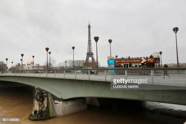 A photo taken on January 5 2018 shows waters of the river Seine which level has risen near the statue of the Zouave at the Alma bridge in Paris PHOTO...