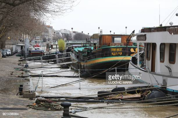 A photo taken on January 5 2018 shows waters which level has risen on the banks of the river Seine in Paris following heavy rains PHOTO / ludovic...