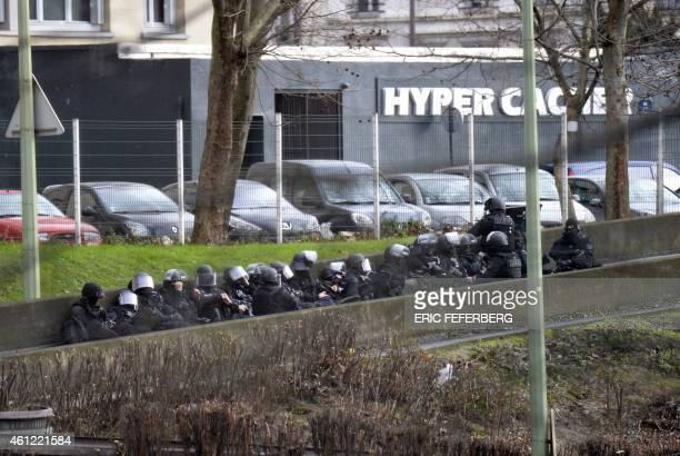 A photo taken on January 9 2015 shows members of the French police forces taking position by the Hyper Cacher kosher grocery storein SaintMande near...