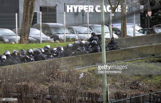 A photo taken on January 9 2015 shows members of the French police forces taking position by the Hyper Cacher kosher grocery storein Porte de...