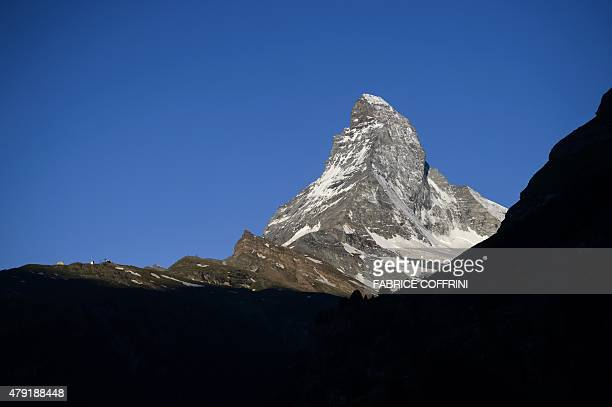 A photo taken on July 1 2015 in Zermatt shows the Matterhorn at sunrise The resort celebrates this year the 150th anniversary of the iconic Alpine...