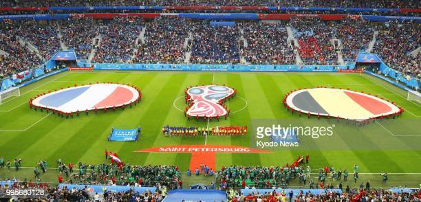 Photo taken on July 10 2018 at Saint Petersburg Stadium in Russia shows giant versions of the national flags of France and Belgium laid out on the...