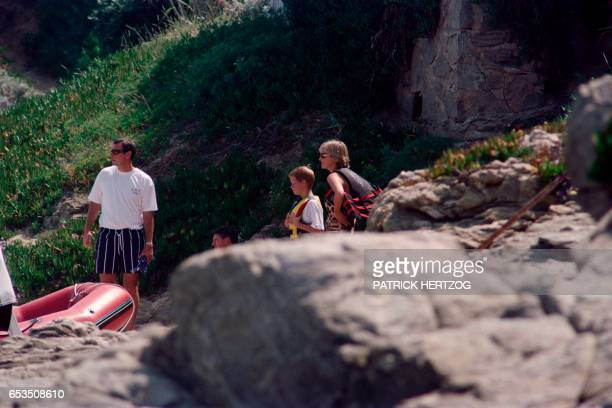 Photo taken on July 14 1997 shows Britain's Lady Diana spending holidays with her son Harry near the property of her friend Dodi AlFayed in Saint...