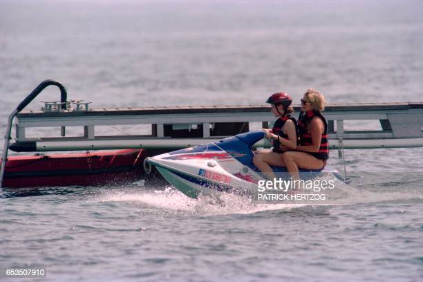Photo taken on July 14 1997 shows Britain's Lady Diana taken by an unidentified young girl for a jetski ride off the property of her friend Dodi...