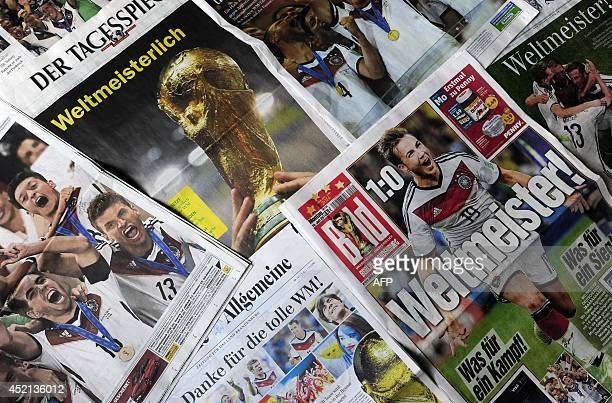 Photo taken on July 14, 2014 in Berlin shows frontpages of German newspapers announcing Germany's champion title after German national football team...