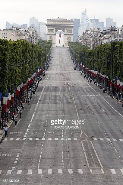 A photo taken on July 14 2014 shows the ChampsElysees avenue in Paris after the annual Bastille Day military parade AFP PHOTO / POOL / THOMAS SAMSON