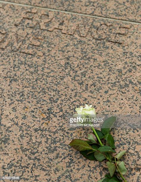 A photo taken on July 16 2016 shows a white rose during a tribute to the victims of the July 14 attack in Nice at the Monument of Remembrance in...