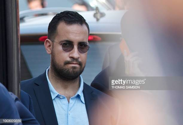TOPSHOT A photo taken on July 16 2018 shows Elysee senior security officer Alexandre Benalla standing next to a bus and the plane transporting the...