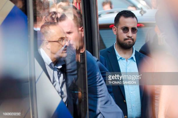 A photo taken on July 16 2018 shows Elysee senior security officer Alexandre Benalla standing next to a bus and the plane transporting the France's...