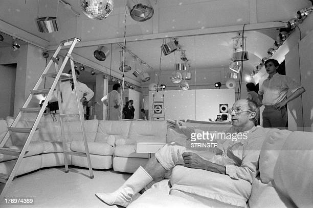 A photo taken on July 17 1973 shows French fashion designer Andre Courreges preparing a collection in his atelier in Paris AFP PHOTO