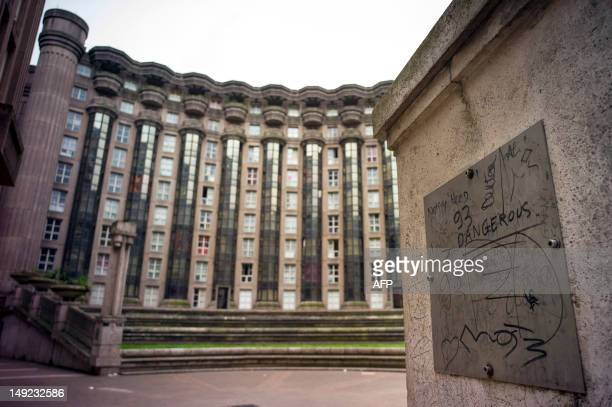 A photo taken on July 17 2012 shows a graffiti in the courtyard of the Espaces d'Abraxas in the eastern Paris suburban town of NoisyleGrand The...