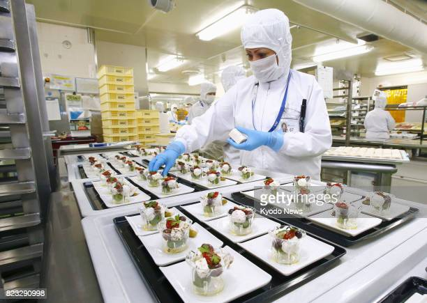 Photo taken on July 18 shows a factory in Narita Chiba Prefecture east of Tokyo processing inflight meals for All Nippon Airways ==Kyodo