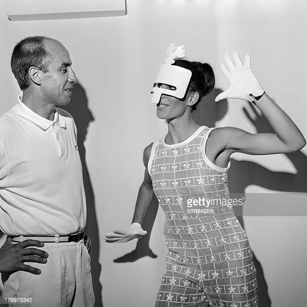 A photo taken on July 2 1967 shows French fashion designer Andre Courreges and a model wearing a 1967/1968 haute couture collections creation AFP...