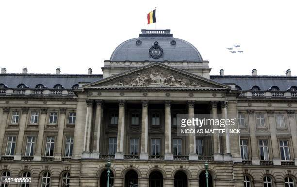 Photo taken on July 21, 2014 shows the Royal Palace during the military parade in Brussels on Belgian National Day. AFP PHOTO / BELGA / NICOLAS...
