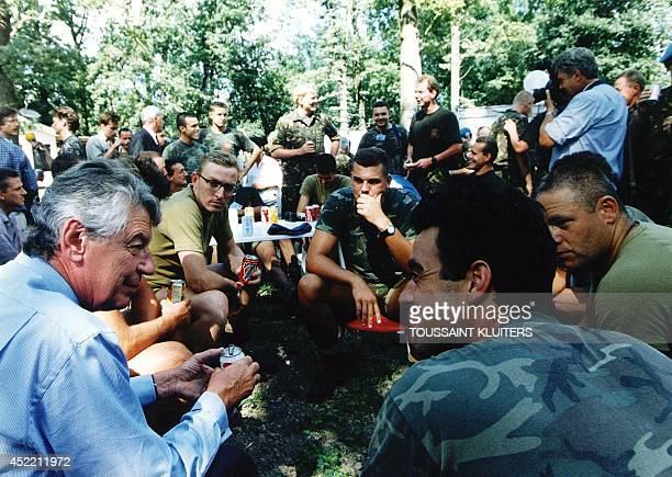 Photo taken on July 23 1995 shows then Dutch Prime Minister Wim Kok talking to UN troops at Camp Pleso in Zagreb after they returned from Potocari in...