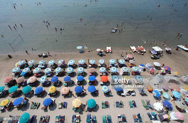 A photo taken on July 23 2015 shows an aerial view of a crowded beach of the Adriatic Sea in the city of Durres Hot weather conditions have reached a...