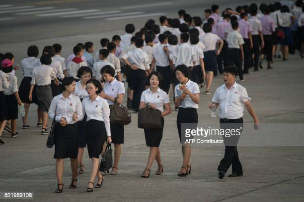 A photo taken on July 24 2017 shows a group of university students walking on a street in Pyongyang / AFP PHOTO / Ed JONES