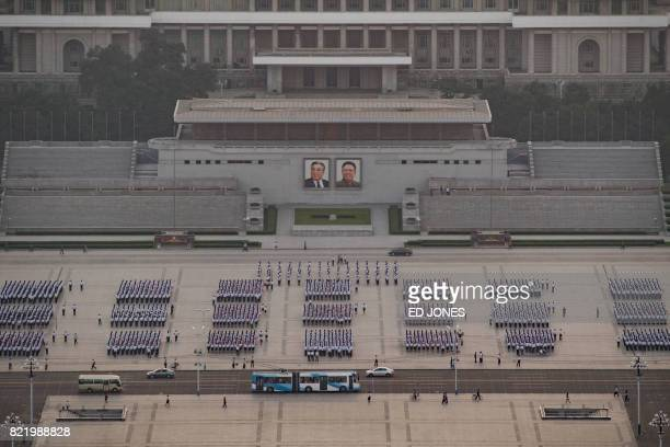 A photo taken on July 24 2017 shows groups of people gathered on Kim IlSung square ahead of 'Victory Day' celebrations in Pyongyang In North Korea...