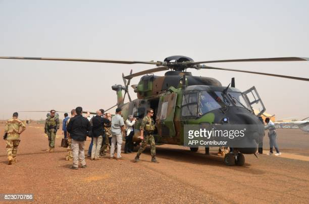 A photo taken on July 25 2017 shows a German helicopter crew near their NH90 Caiman transport helicopter on the ground at Gao airport in Mali A UN...