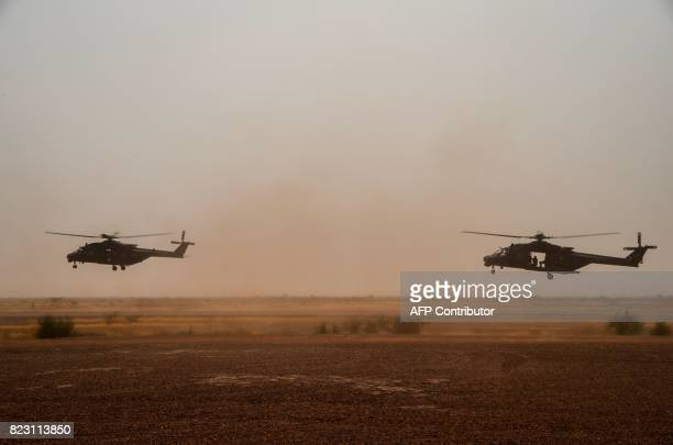 A photo taken on July 25 2017 shows NH90 Caiman transport helicopters piloted by German soldiers taking off from Gao airport in Mali A German...