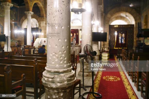 Photo taken on July 27 shows the damage to the interior of Saint Mark's Coptic Orthodox Cathedral in Cairo where Mahmoud Shafiq carried out a suicide...