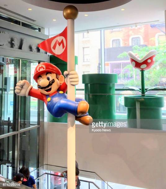 Photo taken on July 29 shows Super Mario decoration in a store selling games and goods related to Nintendo Co in New York Nintendo is close to an...