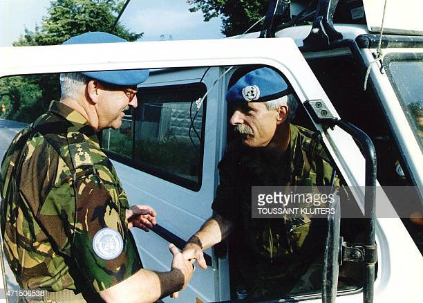 Photo taken on July 30 1995 shows General Couzy shaking hands with Colonel Karremans commander of 'Dutchbat' troops in Srebrenica at the time of the...