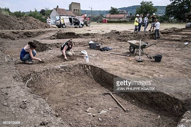 A photo taken on July 4 2014 shows archaeologists at work at a site near the Roman temple of Janus in the centraleastern French city of Autun where...