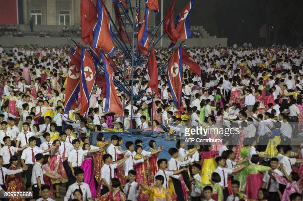 A photo taken on July 6 2017 shows dancers performing during celebrations marking the July 4 launch of the Hwasong14 intercontinental ballistic...