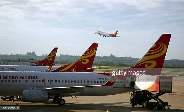 A photo taken on June 12 2014 shows planes belonging to China's Hainan Airlines at the gate at Haikou airport in south China's Hainan province Hainan...