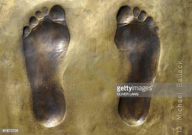 Photo taken on June 13, 2008 shows the footprints of German midfielder Michael Ballack part of a sculpture bearing the footprints of the German...