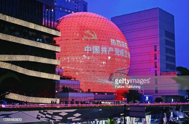 Photo taken on June 13, 2021 shows a red propaganda film for the centenary of the founding of the Communist Party of China on a giant ball screen at...