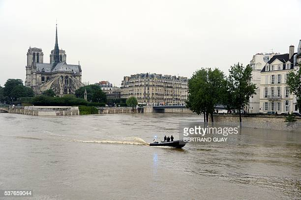 A photo taken on June 2 2016 shows the flooded banks of the river Seine in Paris Torrential downpours have lashed parts of northern Europe in recent...