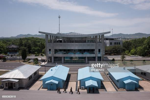 A photo taken on June 2 2017 shows a general view of the military demarcation line separating North and South Korea from the northern side of the...