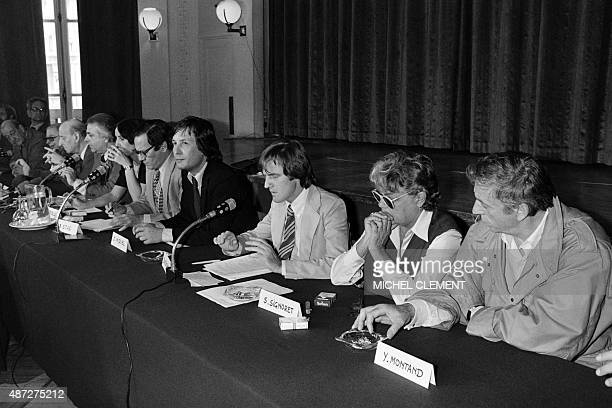 A photo taken on June 20 1979 in Paris shows Yves Montant Simone Signoret Bernard Kouchner and JMiquel at the Lutetia hotel during a press conference...