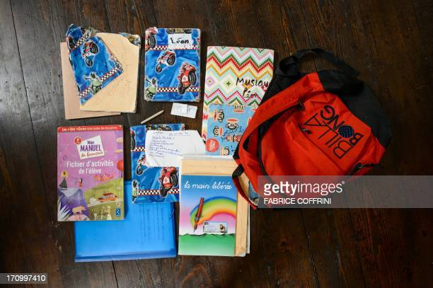 A photo taken on June 20 2013 shows the schoolbag of Swiss boy Leon and its contents at his home in Moudon western Switzerland USE