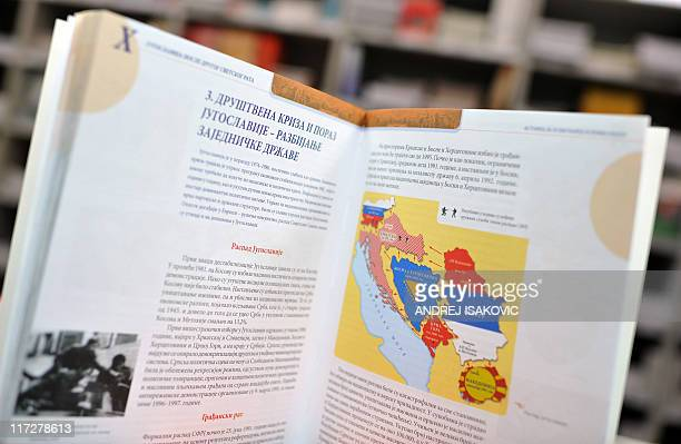 A photo taken on June 23 2011 in Belgrade shows a Serbian history textbook featuring a map of the former Yugoslavia and a lesson about the breakup of...