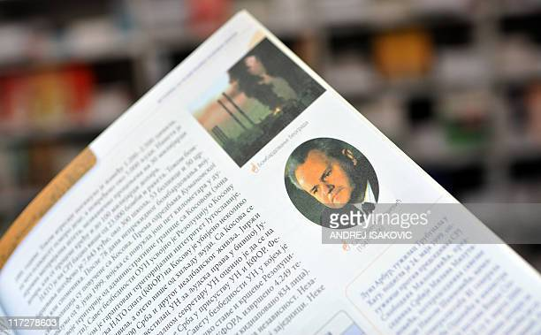 A photo taken on June 23 2011 shows a Serbian history textbook featuring pictures of late Serbian President Slobodan Milosevic and NATO air strikes...